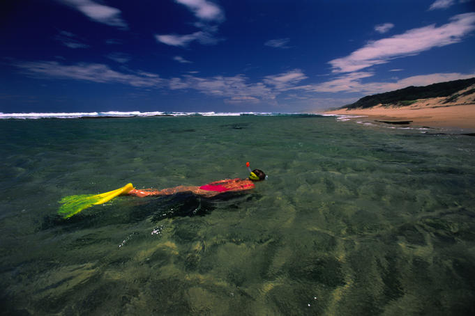 The sandy dunes of LaLa Nek and Mabibi can be seen behind a prime snorkelling spot in Rocktail Bay.