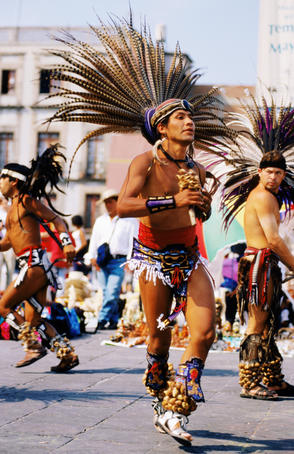 Conchero dancer (Aztecs) with feathers and shells.