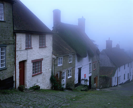 Street of 'Gold Hill' shrouded in fog.