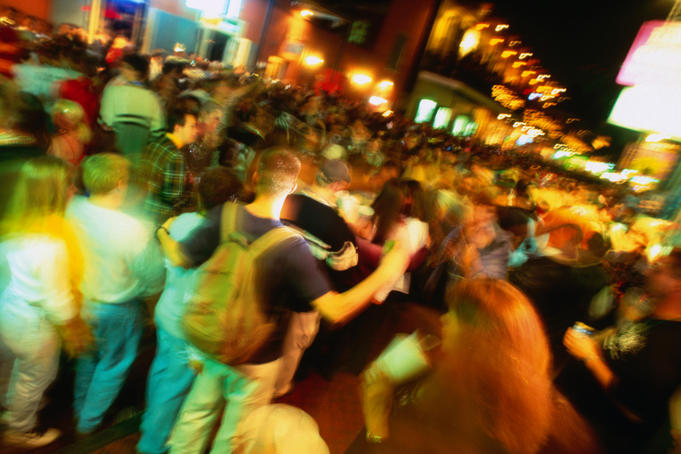 Night-time revellers on Bourbon Street in the New Orleans French Quarter.