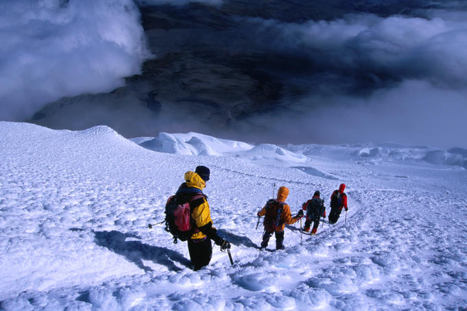 Climbers descending after a successful ascent of Volcan Cotopaxi (5897m).