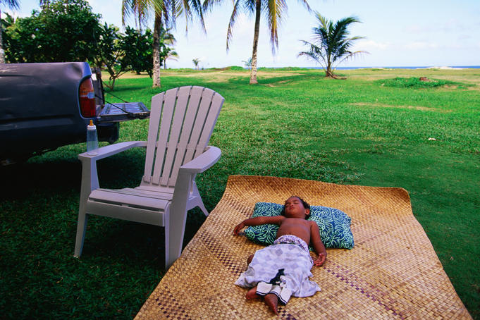 Boy sleeping outside Vaoto Lodge, Manua'a Islands.