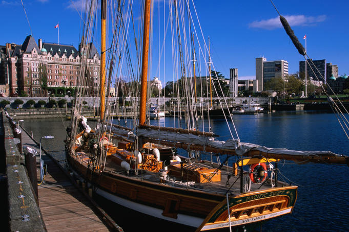 Historic sailing vessel and Empress Hotel in background.