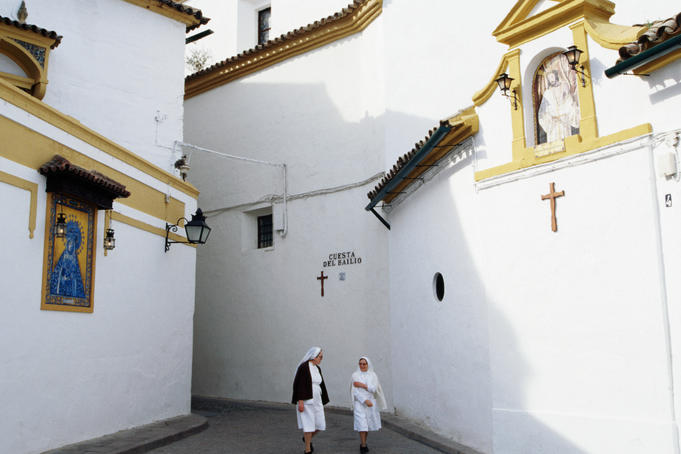 Nuns in alley near Casa de los Fernandes de Cordobaa and Convento de Capuchinos.