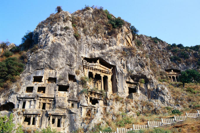 The Tombs of Amyntas (350 BC), a Doric temple facade carved into the rockface, Fethiye