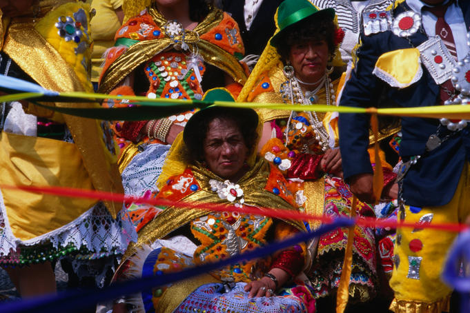 Ladies in traditional festival dress watching the parade during the Senor de Torreschally festival in Lima.