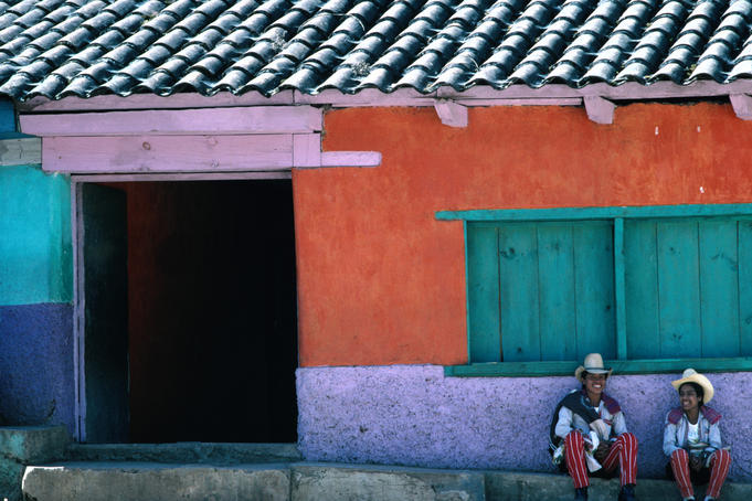 Two Mayan boys sitting in front of house, Todos Santos Cuchumatan.