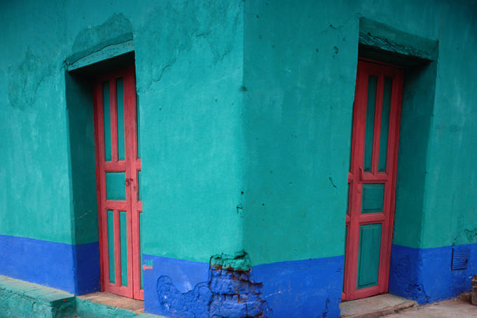 Brightly painted corner house in Chinique.