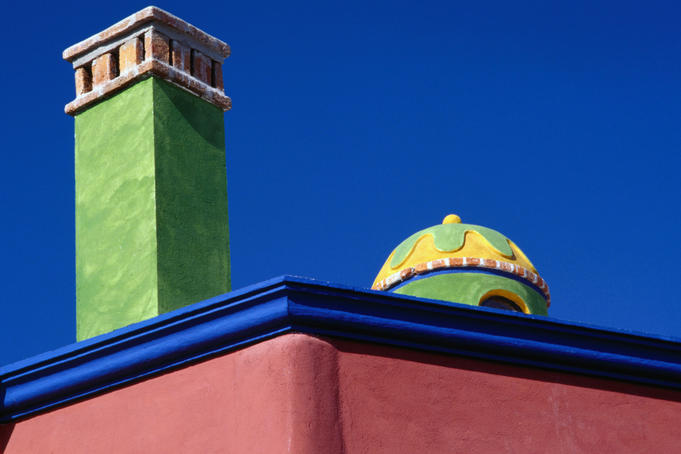 Colourfully painted chimney and dome of a house in San Miguel de Allende.