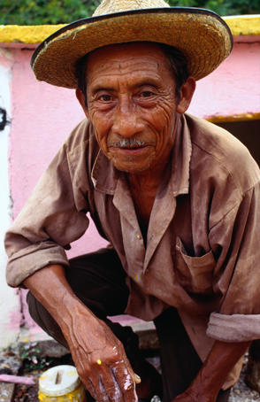 Portrait of Maya labourer at his family tomb on Day of Dead in Pomuch.