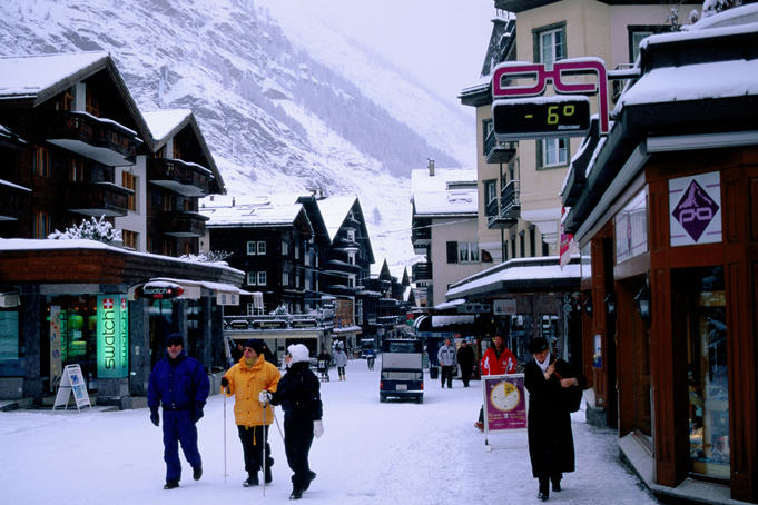 Main street in montain village of Zermatt, Swiss Alps.