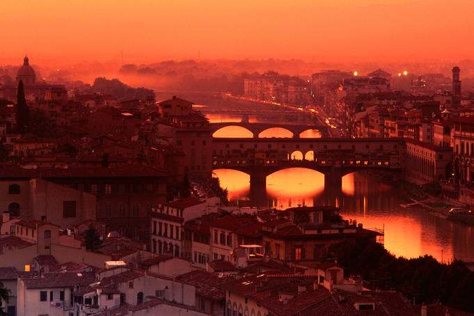 High angle view of Arno River and Ponte Vecchio at sunset.