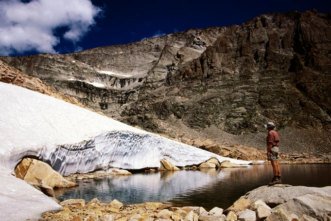 Hiker standing in Snowbank Lake.