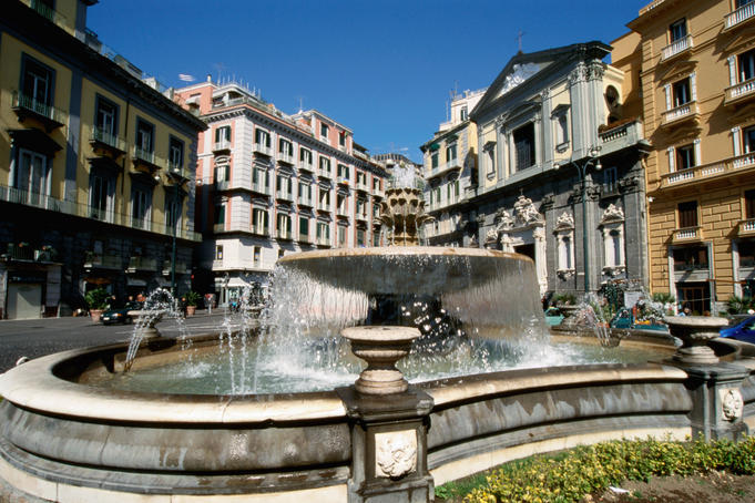 Fountain on Piazza Trento e Trieste with grey Chiesa San Ferdinando behind second on right.