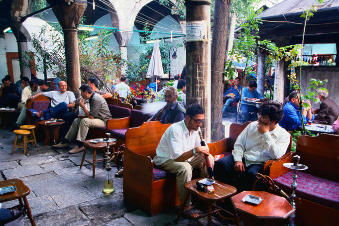 People talking and smoking in the Mystical Water Pipes and Tea Garden - Istanbul