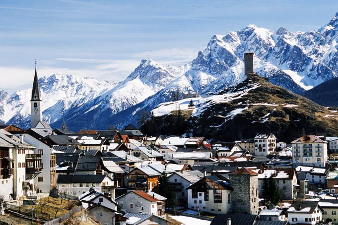 Village in Unter-Engadine Valley with Piz Leschana in background.