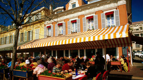 Colourful restaurants and crowds in Cours Saleya.