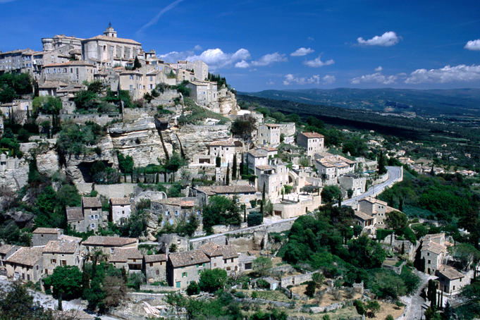 Provence. Tiered Vaucluse village of Gordes sits on a white rocky hill.