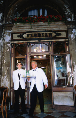 Waiter and doorman at door of Caffe Florian on Saint Marks Square (Piazza San Marco).