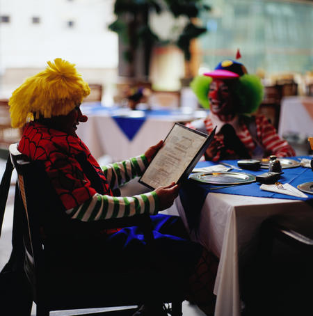 Clowns reading menu at clown convention.