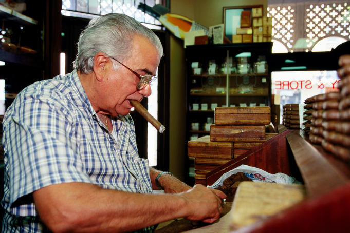 Cigar maker at work.