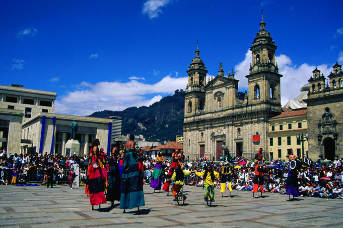 Crowds gather to watch street theatre performances in the Plaza de Bolivar - Bogota, Bogota Capital District