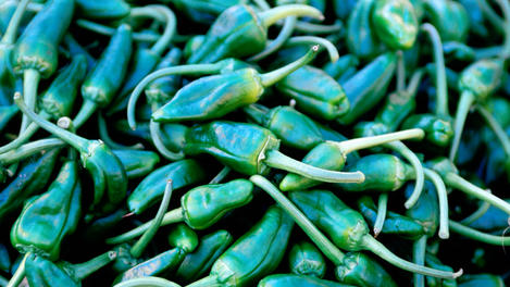 Detail of green chillies at market.