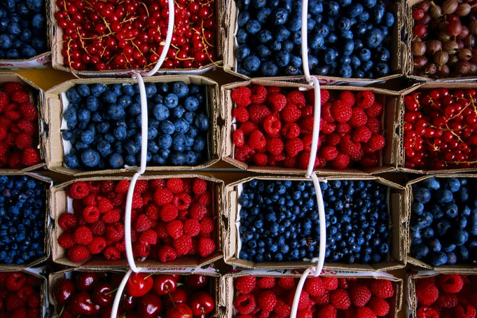 Overhead of punnets of berries, Jean Talon Market.