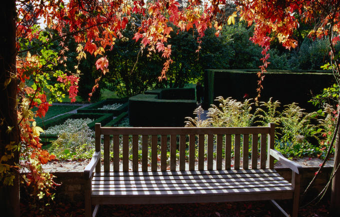Bench and autumn leaves at Musee David et Alice Van Buuren (museum), Uccle.