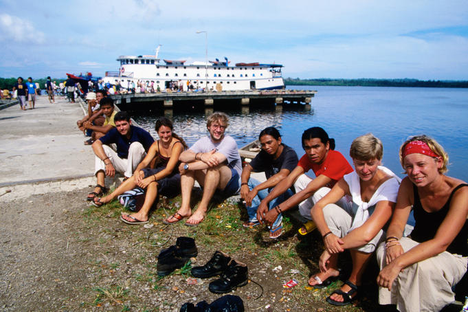 Tourists waiting for departure of Padang ferry at Maura Sikabaluan.