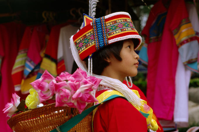 Girl in traditional costume, Stone Forest.