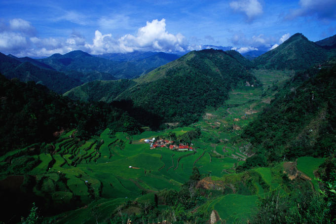 Village set amid rice terraces and mountains.