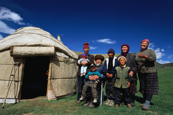 Krygz family portrait outside summer yurt, outside of Kochkor.