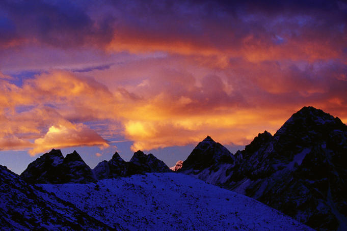 Mountains silhouetted at sunset.