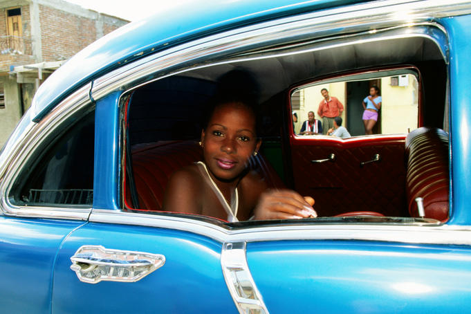 Young woman in 1956 Chevrolet Bel-Air.
