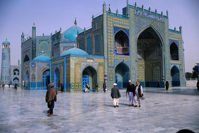 People walking outside Shrine of Hazrat Ali (Blue Mosque).