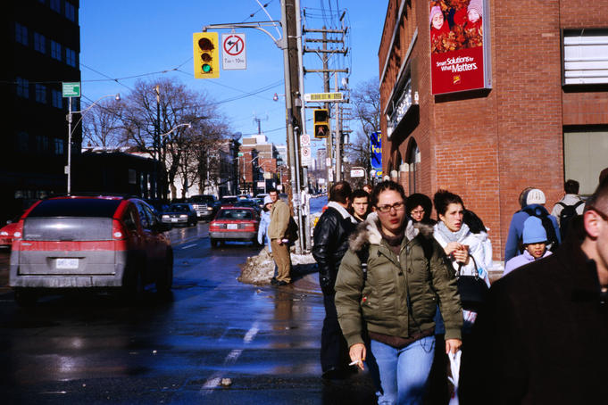 Pedestrians and traffic along Bloor St in The Annex.