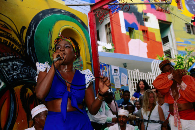 Afro-Cuban singer performing rhumba at Callejon de Hamel (Salvador's Alley).