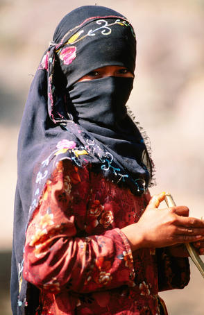 Portrait of Muslim woman in headscarf.