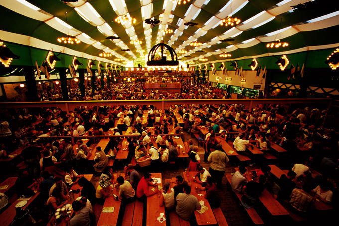Overhead of Oktoberfest beer-drinking session in tent at Theresienwiese fairgrounds.