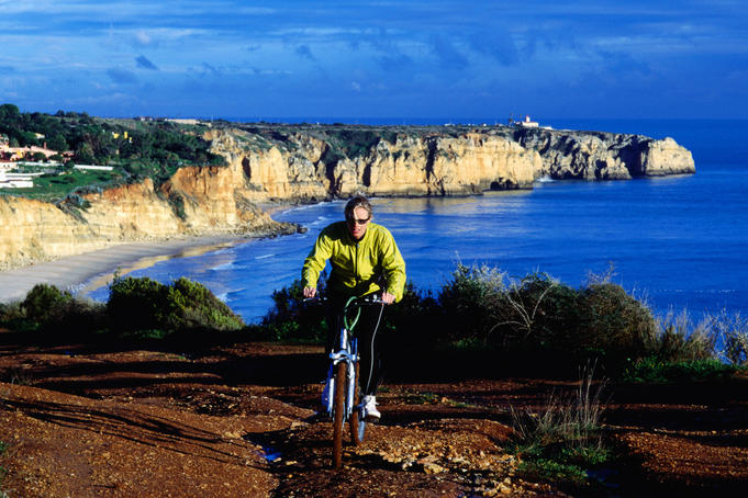 Biking above Algarve coast near Lagos.
