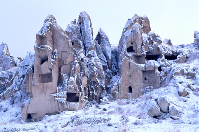 Snow-capped rock caves and pigeon houses near Goreme.