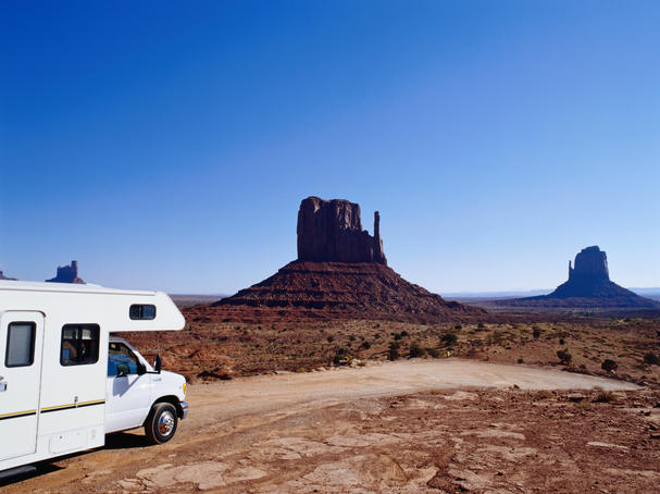RV (campervan) in front of mittens and mesas.
