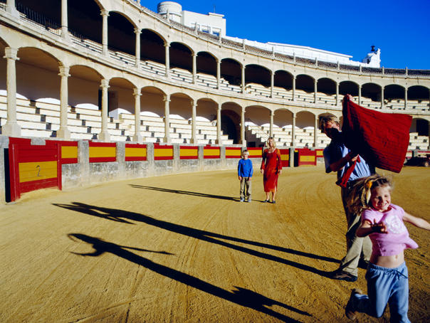 Family in bullfighting ring.