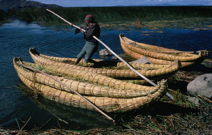 Local fisherman with totoro reed boat on Lake Titicaca