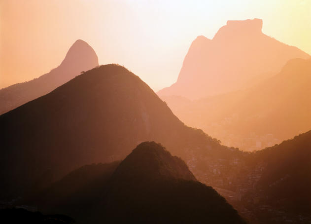 Rio, Sugarloaf Mountain and Tijuca Mountains at sunset.