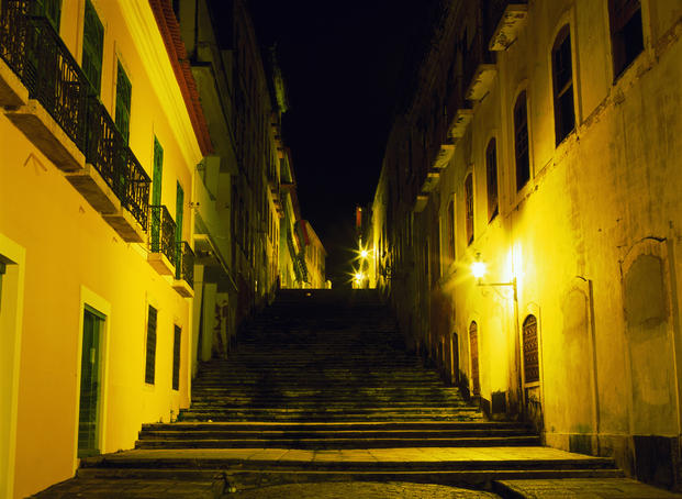 Stairway between Colonial-era houses lit up at night São Luis