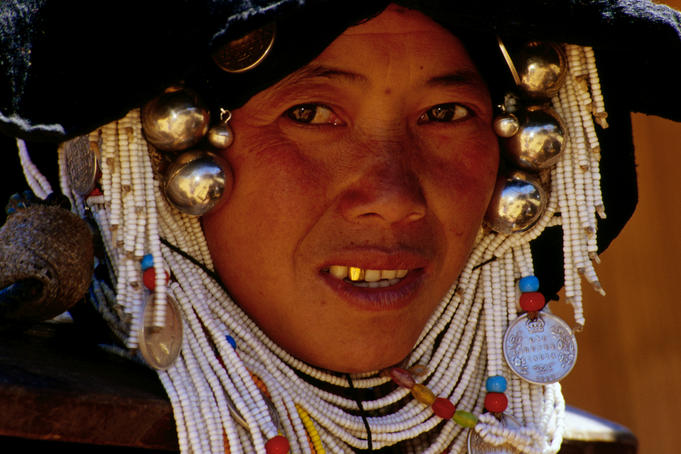 An alternative to the money belt is braiding loose change into your headdress