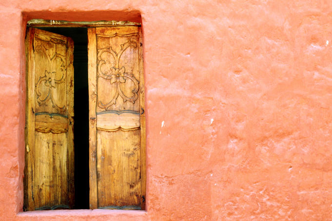 Carved door and painted facade at Monastery of Santa Catalina, Arequipa