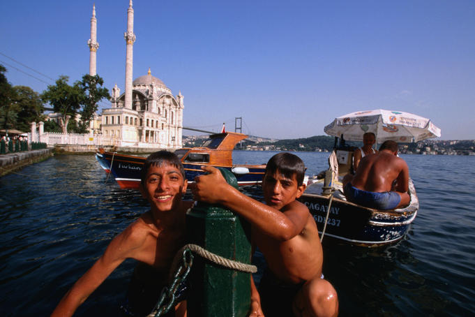 Kids with Ortakoy Mosque in background.